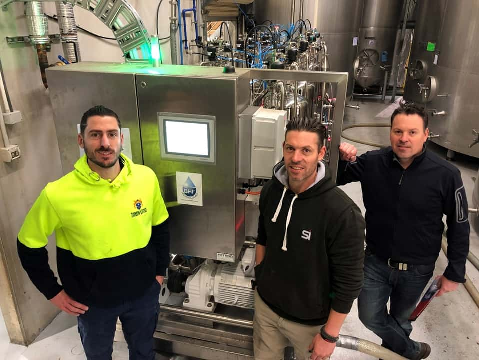 Julian Daniel and Damien Torresan with automated filtration system